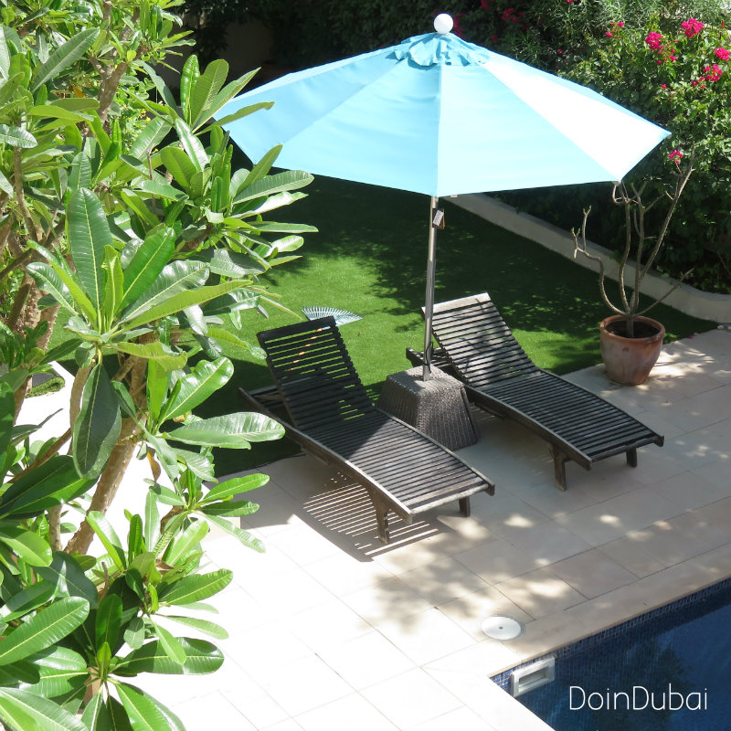 Illuminated Parasol DoinDubai Blue from balcony plus pool