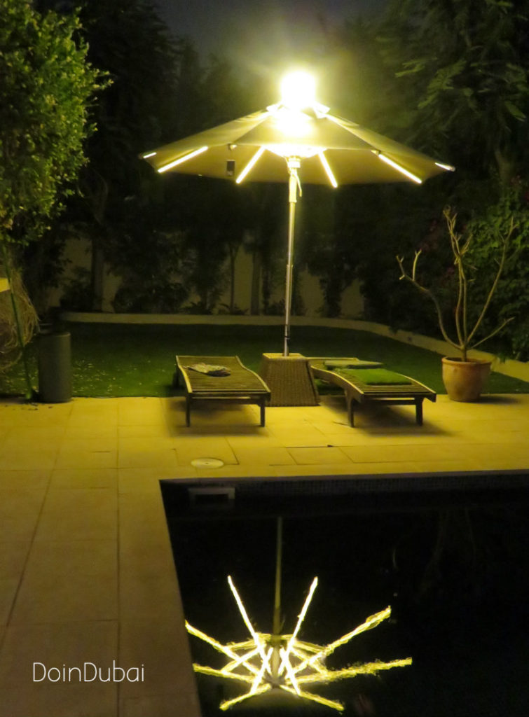 Illuminated Parasol DoinDubai Full lenght at night beige parasol