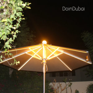 Illuminated Parasol DoinDubai at night with plant edging