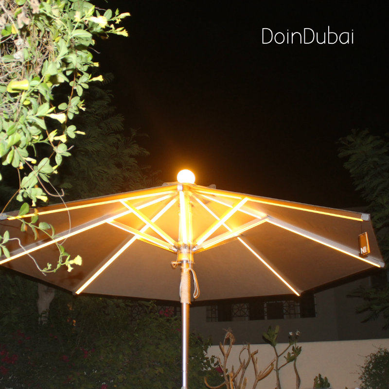 Illuminated Parasol DoinDubai at night with plant edging