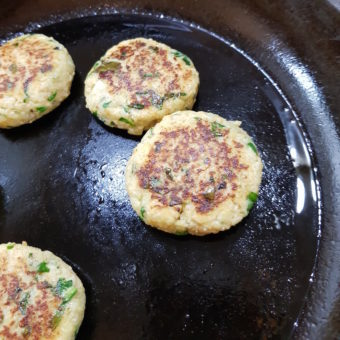 Image ofCauliflower Burgers DoinDubai Vegan Fry till golden brown