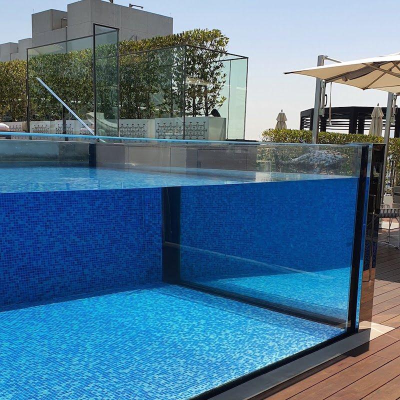 Four Seasons Hotel DIFC Monica Kapila DoinDubai side view glass pool